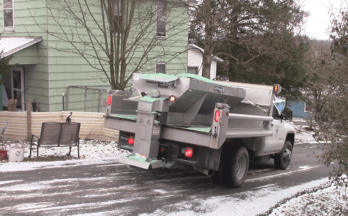 A Morgantown Public Works Salt Truck spreading salt.