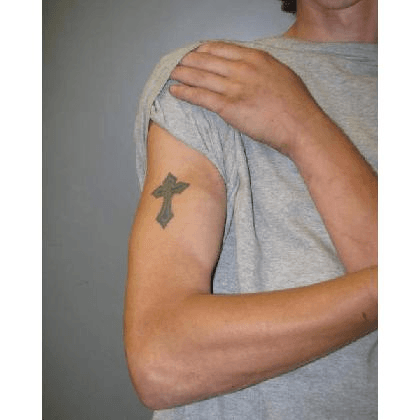 A picture of a cross tattoo on Dylan Yoders upper right arm.