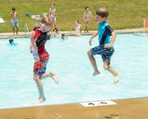 Children Jump into Pool