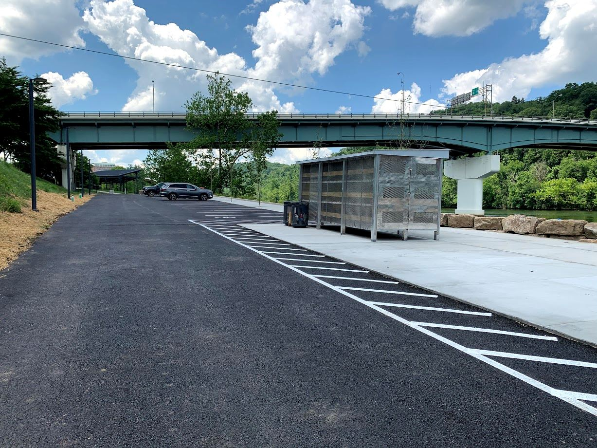 Image of kayak locker and paved parking lot at Walnut Street Landing